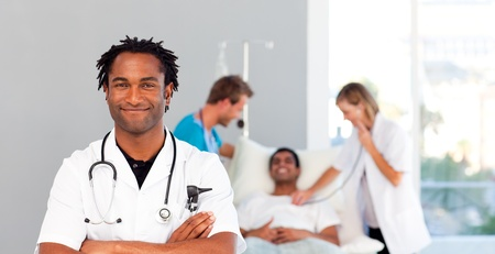Portrait of an African doctor with a patient in the background photo