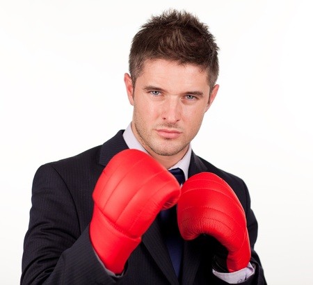 Businessman with boxing gloves on photo