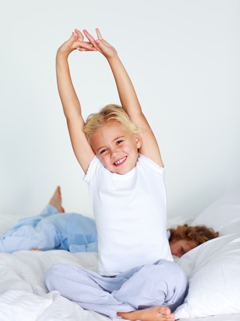 sleeping girl: Young child stretching after sleeping Stock Photo