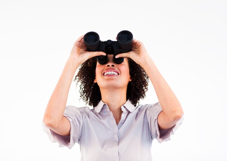 Portrait of ethnic businesswoman holding binoculars upwards Stock Photo - 10093830