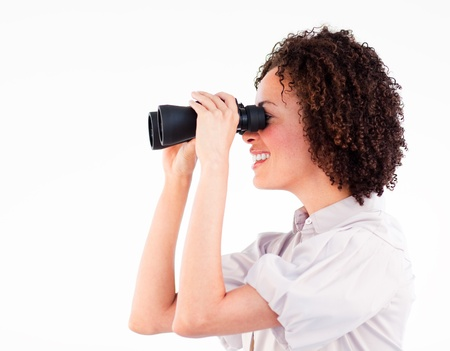 Smiling brunette businesswoman looking through binoculars Stock Photo - 10109766