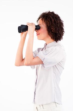 Sideways portrait of businesswoman with binoculars Stock Photo - 10095941
