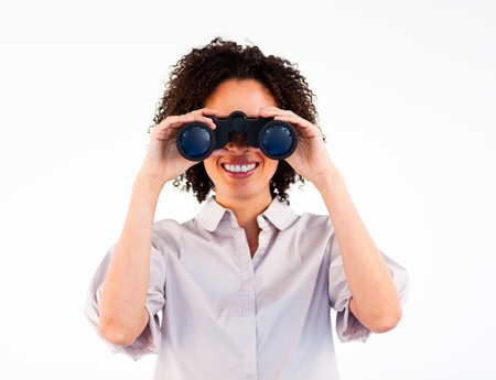Close-up of smiling businesswoman looking through binoculars photo