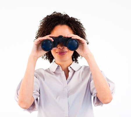 Young businesswoman searching for something with binoculars photo