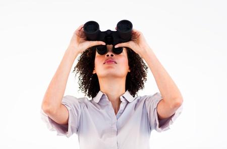 Ethnic businesswoman holding binoculars upwards Stock Photo - 10093822