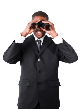 Handsome businessman looking through binoculars photo