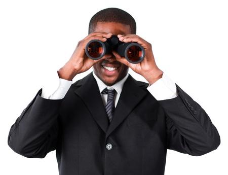 Close-up of an smiling businessman looking through binoculars photo