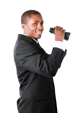 Afro businessman looking with binoculars downwards photo