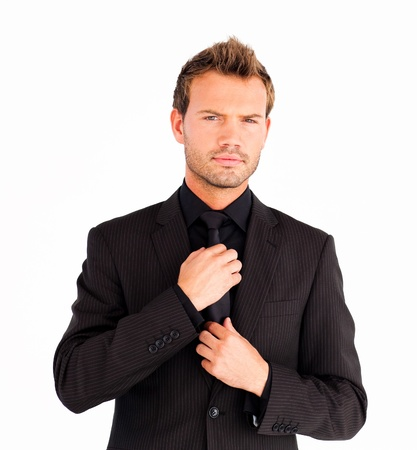 suit  cuff: Young businessman corrects a tie