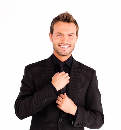 suit  cuff: Attractive businessman corrects a tie