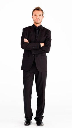 folded arms: Serious businessman with folded arms