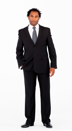 Serious businessman standing in front of camera photo