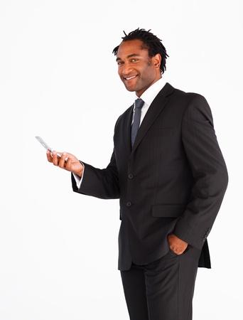 Serious businessman sending text message photo