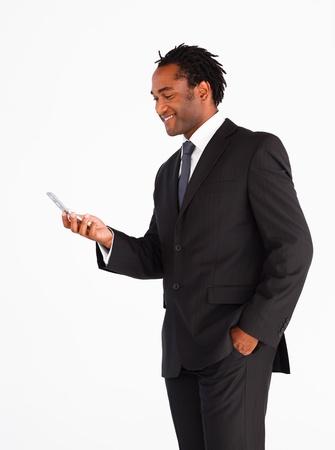 Handsome businessman sending text message photo