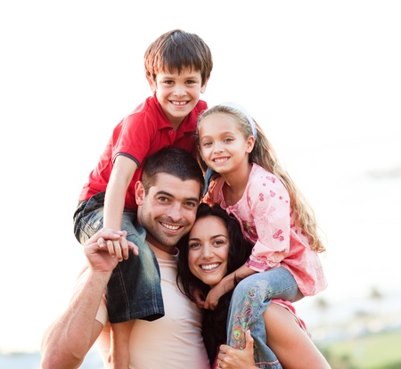 Parents giving children piggyback rides Stock Photo - 10109789