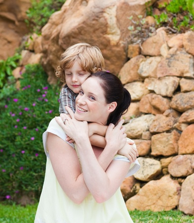 Mother giving son piggyback Stock Photo - 10110753