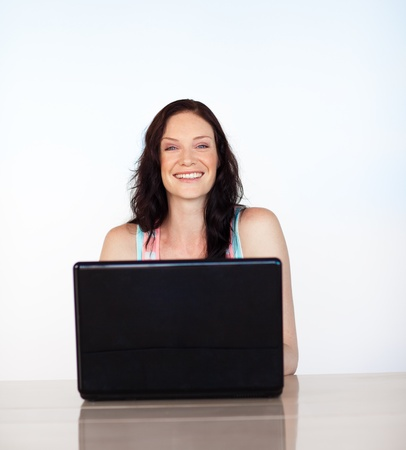 Portrait of a smiling girl working with a laptop Stock Photo - 10110733