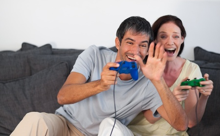 Beautiful family playing video games Stock Photo - 10093521