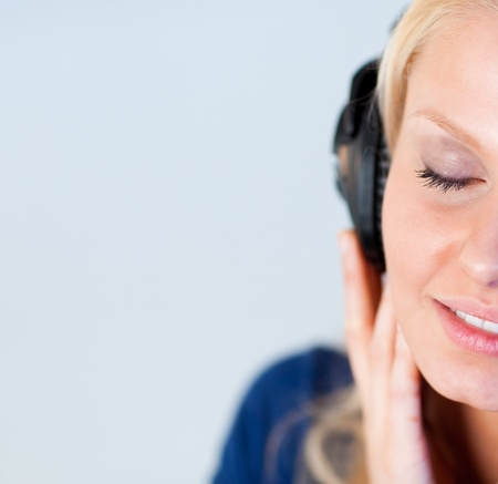 Relaxed woman listening music with headphones  photo