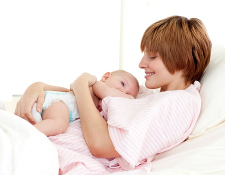 Patient and newborn baby in bed Stock Photo - 10109415