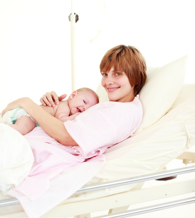 Patient with newborn baby in bed smiling at the camera Stock Photo - 10110443
