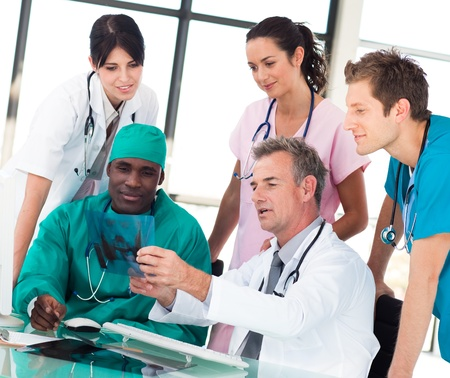 Medical team discussing in an office  photo