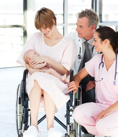 Patient with her newborn baby and doctors Stock Photo - 10112848
