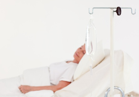 eye patient: Relaxed patient lying on a medical bed