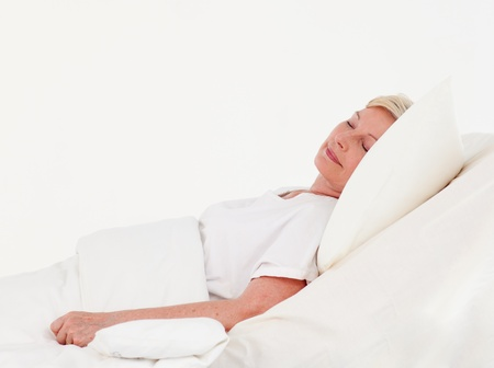 parkinsons: Cute patient lying on a medical bed Stock Photo