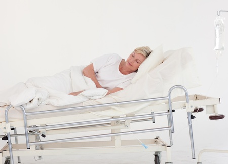 Senior patient lying on a medical bed photo