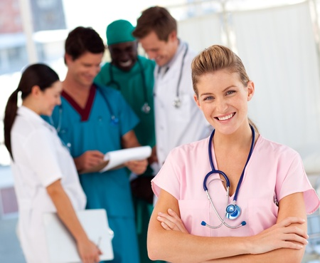 general practitioner: Nurse with doctors in the background
