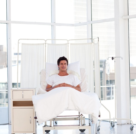 operation room: Smiling patient recovering in a hospital Stock Photo