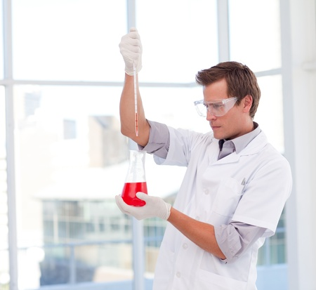 Scientist examinig a test-tube Stock Photo - 10110593