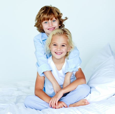 Brother hugging his sister good night Stock Photo - 10110050