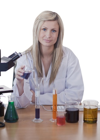 Woman scientist conducting experiment photo