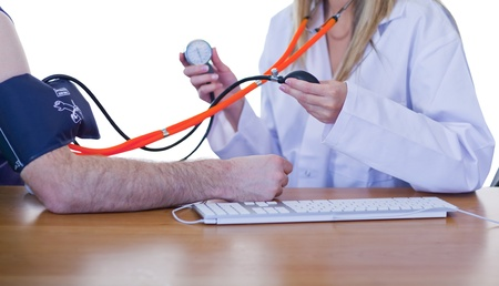 Doctor measuring blood pressure of a patient photo
