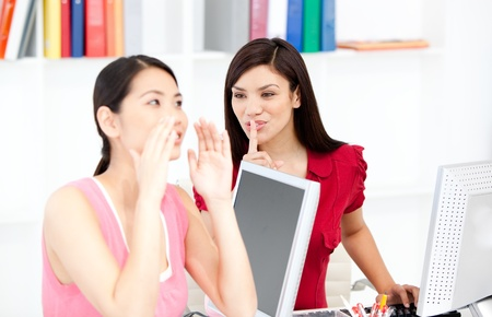 Young businesswoman asking for silence while her colleague shouting Stock Photo - 10113726