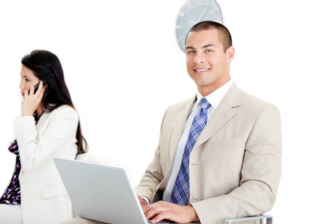 Two business collegues working on a computer  photo