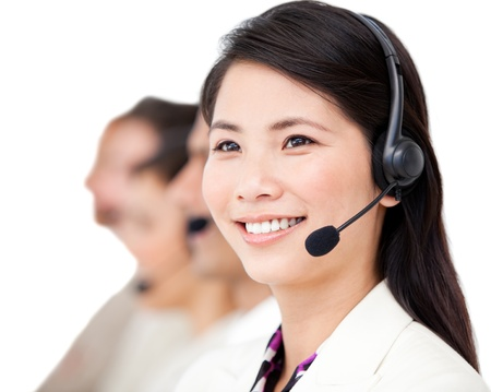 headsets: Diverse business team working together in a office Stock Photo