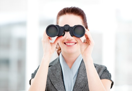 Attractive businesswoman using binoculars  photo