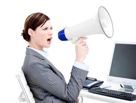 Portrait of a  businesswoman using a megaphone photo