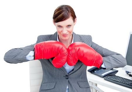 Portrait of a confident businesswoman wearing boxing gloves Stock Photo - 10112758