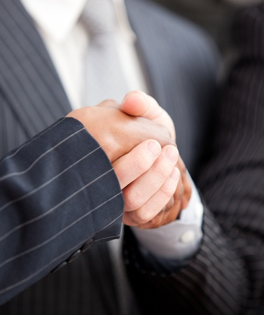 Handshake between two businessmen photo