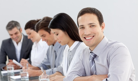 briefing: Young businessman in a meeting with his team  Stock Photo
