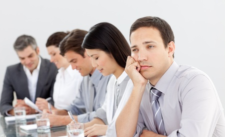 Attractive businessman bored at a presentation photo