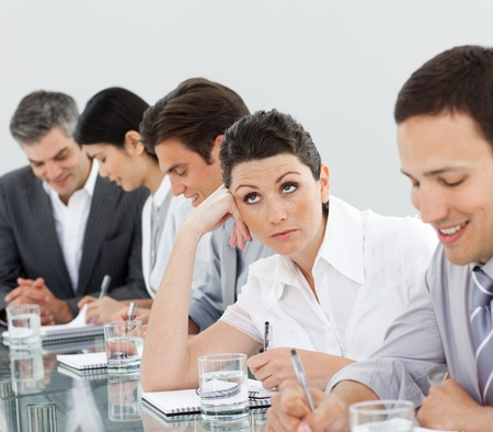Brunette businesswoman bored in a meeting photo