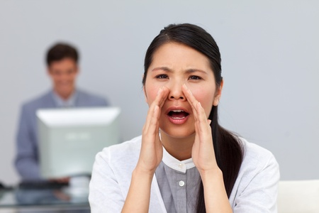timorous: Angry businesswoman shouting in the office