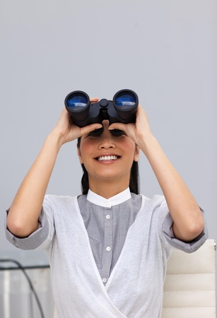 Happy young Businesswoman predicting future success  photo