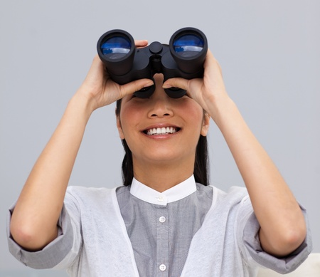 Visionary asian businesswoman looking through binoculars Stock Photo - 10111919