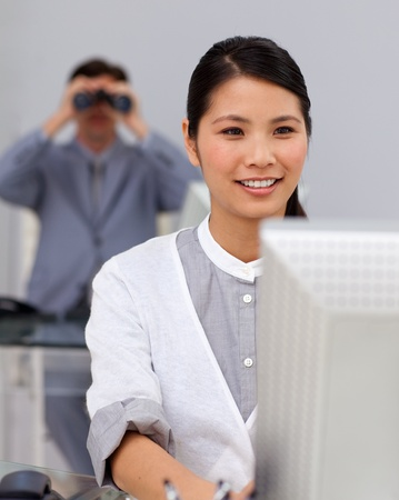 Self-assured asian businesswoman at a computer Stock Photo - 10096048